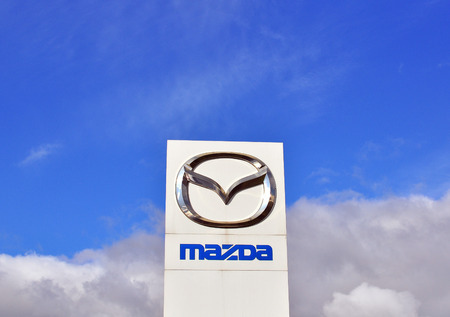 mazda: MOSCOW, RUSSIA - OCTOBER 10, 2015: Logotype of Mazda corporation on October 10, 2015. Mazda is the Japanese automotive manufacturer. Editorial