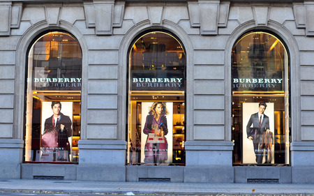 BARCELONA, SPAIN - DECEMBER 9: Facade of Burberry flagship store in Paseo de Gracia, Barcelona on December 9, 2014. Burberry is a luxurious fashion brand founded in Great Britian. Editorial