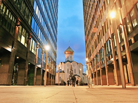 centres: MOSCOW, RUSSIA - DECEMBER 16: View of the church between office centres in Moscow downtown on December 16, 2015. Moscow is the capital and largest city of Russia.