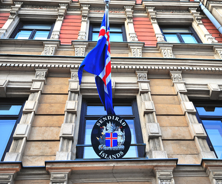 the icelandic flag: HELSINKI, FINLAND - JANUARY 4: View of the icelandic embassy in Helsinki on January 4, 2016. Iceland is a Nordic country located between the North Atlantic and the Arctic Ocean.