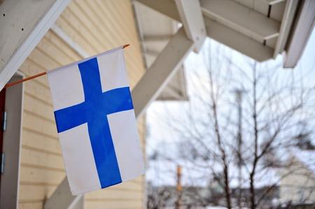 finnish: FInnish house with a flag