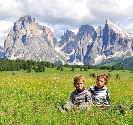alp: Kids in mountains, Dolomites, Italy Stock Photo