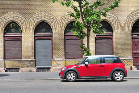 cooper: BUDAPEST, HUNGARY - MAY 16: Mini Cooper parked in the street  of Budapest on May 16, 2016. Mini Cooper is a British automotive marque owned by BMW.