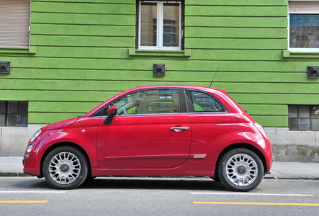 fiat: BUDAPEST, HUNGARY - MAY 16: Fiat 500 parked in the street  of Budapest on May 16, 2016. Fiat 500 is a passenger car manufactured by Fiat since 2007.