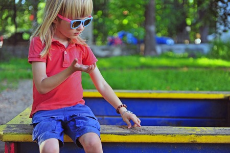 sandbox: Boy sitting in the sandbox Stock Photo