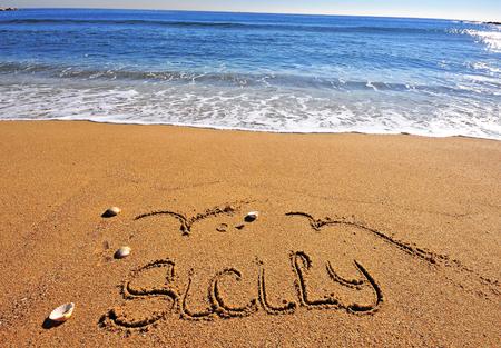 Sicily sign on the sand beach