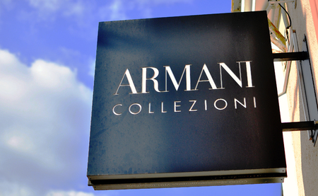 luxe: MINSK, BELARUS - OCTOBER 4: Logotype of Armani Collezioni store in the street of Minsk on October 4, 2014. Armani Collezioni is an italian world famous fashion brand.