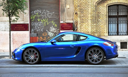 headquartered: BUDAPEST - MAY 20, 2016: Deep blue Porsche sport car in the street of Budapest on May 20, 2016. Porsche is a global automobile manufacturer headquartered in Stuttgart, Germany.
