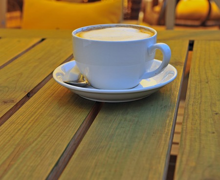 cappucino: Cup of cappucino on the wooden table