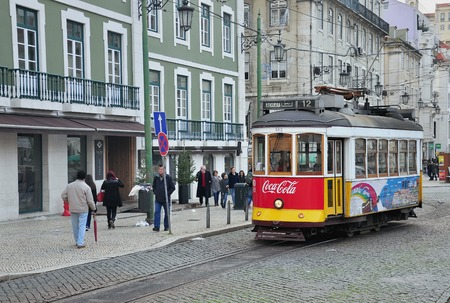 number 12: LISBON, PORTUGAL - DECEMBER 27: Tram number 12 stops at Rossia sqaure in Lisbon on December 27, 2013. Lisbon is a capital and the largest city of Portugal. Editorial