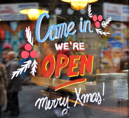 come in: Hand made decorated Come in sign in the street shop Stock Photo