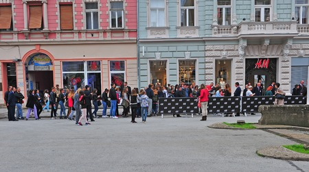 hm: NOVI SAD, SERBIA - MAY 13: People waiting for opening H&M first store in Novi Sad, Serbia on May 13, 2016. Novi Sad is the second largest city of Serbia. Editorial