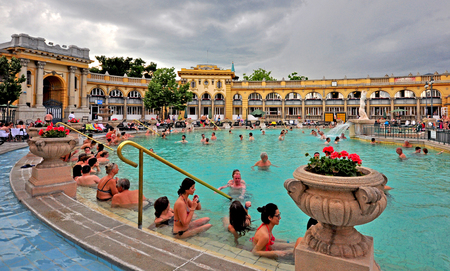 BUDAPEST, HUNGARY - JUNE 1: People in the Szechenyi Medicinal thermal Bath in Budapest on June 1, 2016. Szechenyi is the largest medicinal bath in Europe.