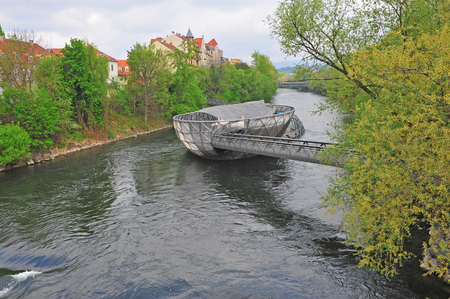 Modern bridge on the river, Graz, Austria Stock Photo