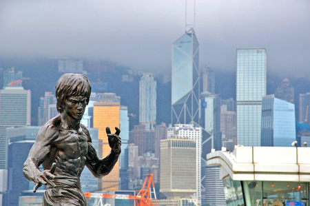 HONG KONG, CHINA - JUNE 10: Monument of Bruce Lee in Avenue of stars in Hong Kong on June 10, 2012. Editorial
