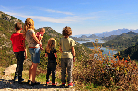 Family standing at viewpoint of Rieka Crnojevica, Montenegro.  Stock Photo