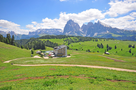 House and winding path in italian Alps, Dolomites, Trentino Alto