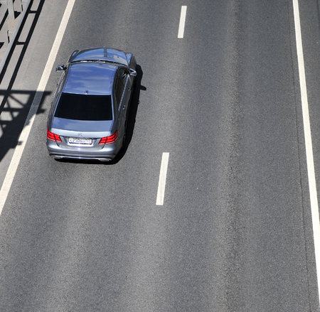 MOSCOW, RUSSIA - JUNE 20: Top view of the car driving on highway, Moscow on June 20, 2018.