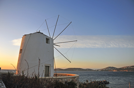 Traditional mediterranean greek windmill on sunset, Paros island, Greece Stok Fotoğraf