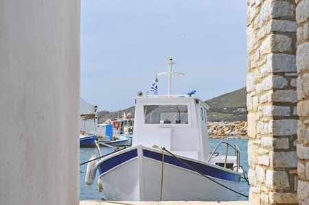 Traditional fisher boat with a national flag of Greece