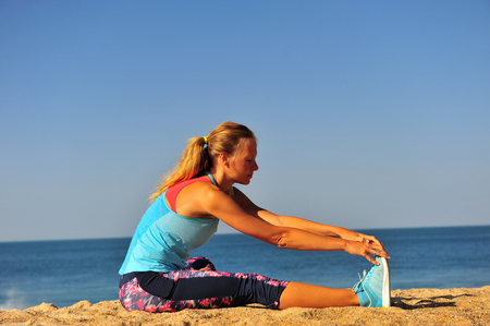 Young caucasian woman on beach acting sport