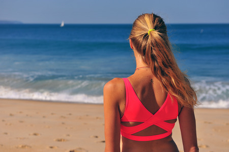 Back view of woman looking at the sea