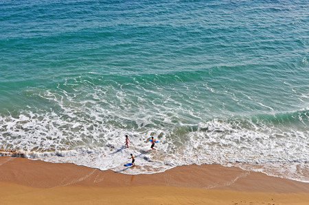 Top view of kids playing in ocean, Portugal