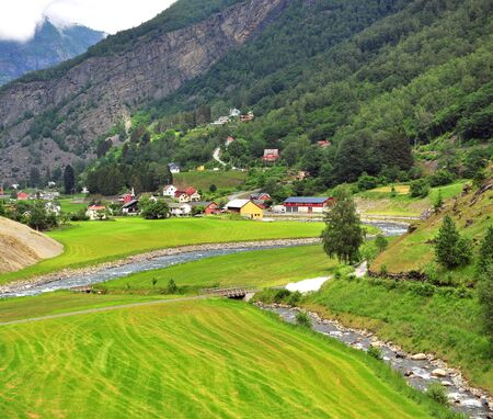 Scenic view of a village under mountains, Norway