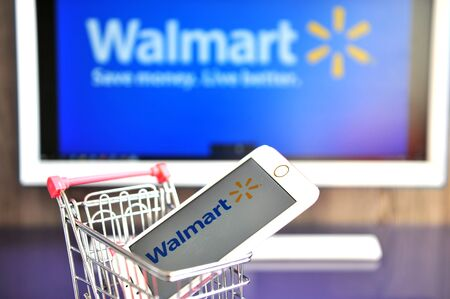 YAROSLAVL, RUSSIA - AUGUST 13, 2019: Walmart logo in mobile phone and monitor. Editorial