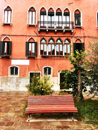 View of red facade of venetian house, Italy