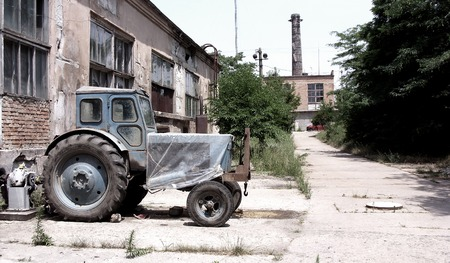 pripyat: Dirty broken Chernobyl abandoned buildings, vacant lots, contaminated land, tractor