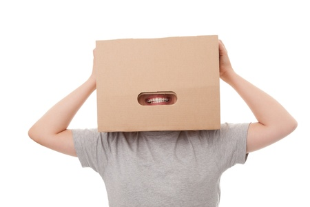 boy with a box on a head, isolated over a white background Stock Photo - 15063760