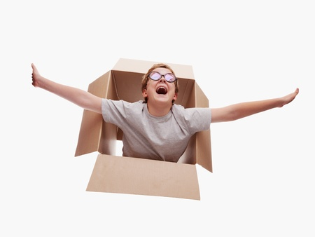 boy in a cardboard box dreams that it flies in an airplane on the sky Stock Photo - 15063761