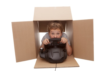 boy-driver of a cardboard box, isolated on white