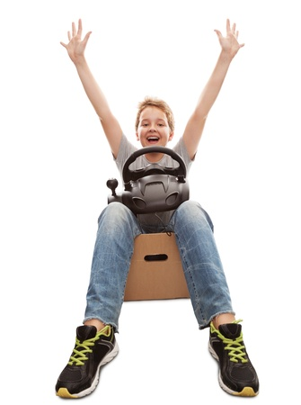 boy-driver of a cardboard box, isolated on white Stock Photo - 15073226