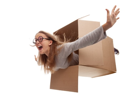 The girl in a cardboard box flies in white background Stock Photo - 15172089