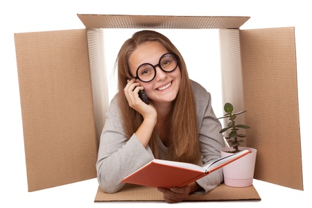 girl has retired to a cardboard box