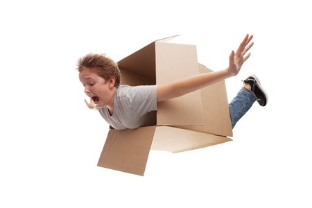 boy in a cardboard box dreams that it flies in an airplane on the sky  Stock Photo - 15615975