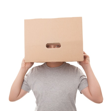 boy with a box on a head isolated on a white Stock Photo - 15843792