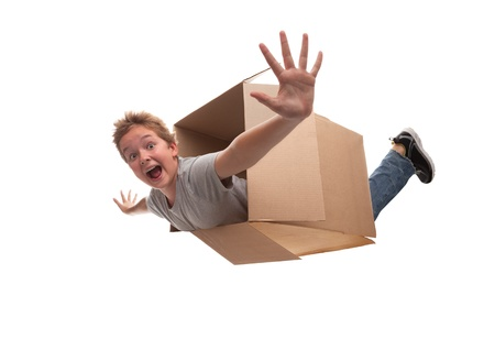 boy in a cardboard box dreams that it flies in an airplane on the sky  Stock Photo - 15843734