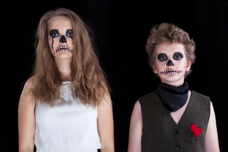 groom and  bride -  zombie, children have put on for Halloween  photo