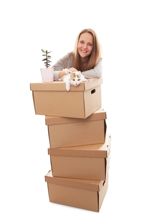 belongings: girl, cardboard boxes and a kitten on a white background Stock Photo