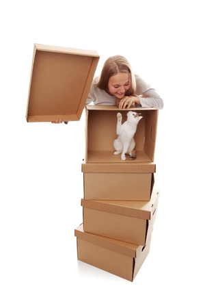 girl, cardboard boxes and a kitten on a white background Stock Photo - 16991949