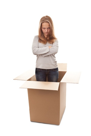 The angry girl in a cardboard box on a white background Stock Photo - 16991944