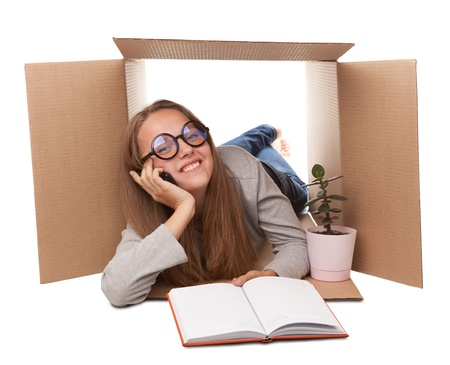 girl has retired to a cardboard box Stock Photo - 16991953