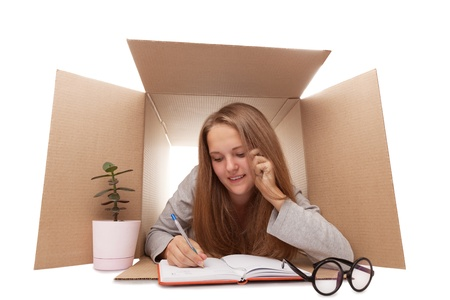crowded space: girl has retired to a cardboard box