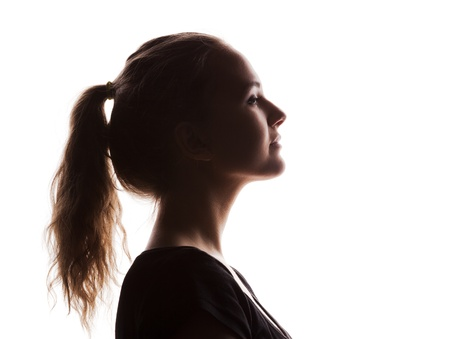 woman portrait profile  in silhouette shadow on studio isolated white background