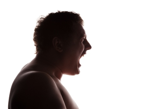 man portrait silhouette profile screaming angry in studio isolated white background  photo