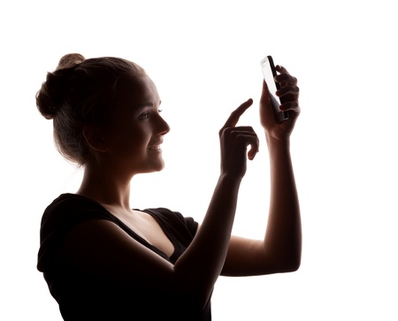 profile  woman in a shade of a silhouette with phone, isolated on a white background