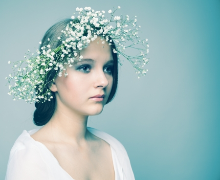 pastel shades: spring portrait  girl with wreath of flowers, pastel shades